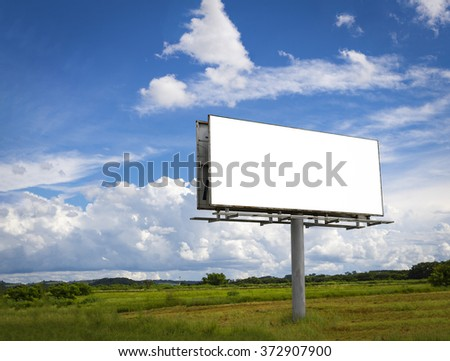 Empty billboard in front of beautiful cloudy sky in a rural location