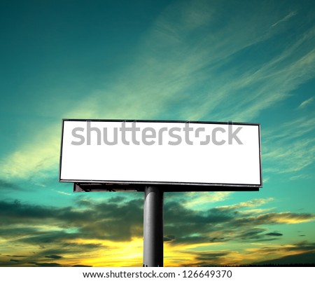 Empty billboard on background of sunset sky - stock photo