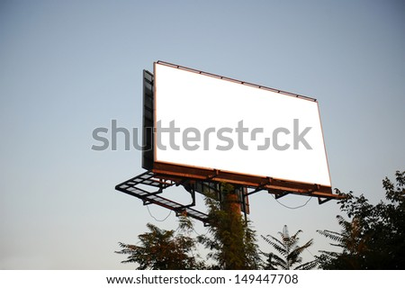 Empty billboard on background of sunset sky - stock photo