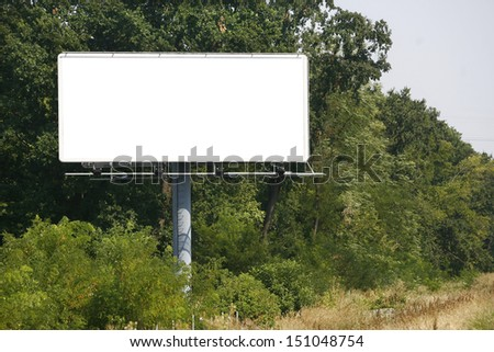 Empty billboard on background of sunset sky for your advertisement - stock photo