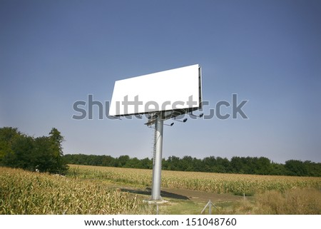 Empty billboard on background of sunset sky for your advertisement