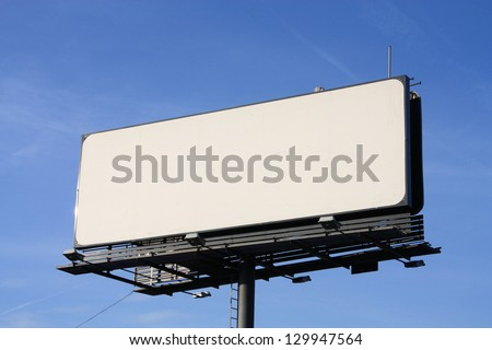 Empty billboard on cloudy sky. - stock photo