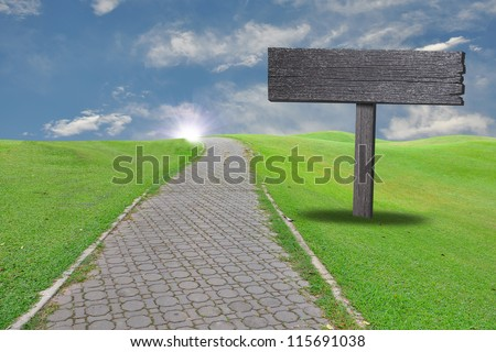 Empty billboard with the country road on blue sky - stock photo