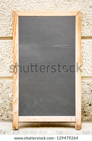 empty black board (menu board) at a restaurant - nice backgroud with space for text - stock photo