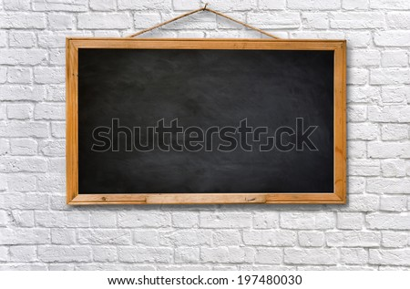 Empty black board on white brick wall texture background - stock photo