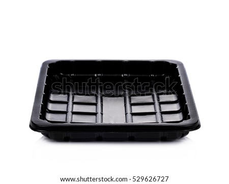 Empty black plastic container isolated on white