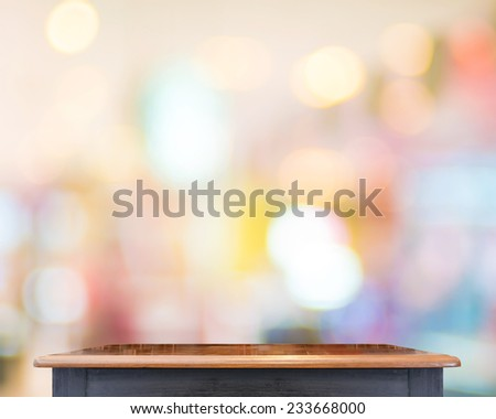Empty Black vintage table top at store blurred background with bokeh light,Template mock up for display of your product. - stock photo