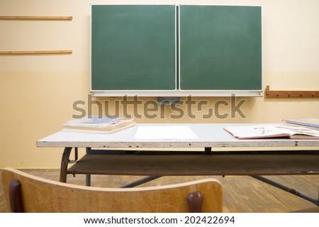 empty blackboard in a classroom / Classroom - stock photo