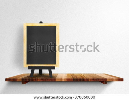 Empty blackboard on wooden shelf at white wall, Mock up for montage your content