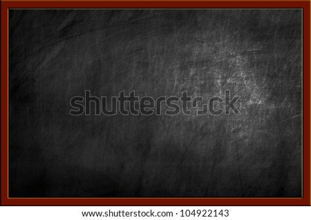 empty blackboard with wooden frame and chalks