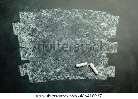 empty blackboard wooden framed soiled with dust of chalk rubbed