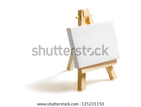 Empty blank canvas on wooden easel isolated on white background