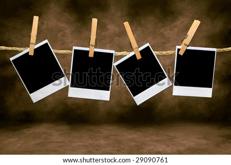 Empty Blank Film Frames Hanging From a Rope By Clothespins. Insert Your Own Images or Text - stock photo
