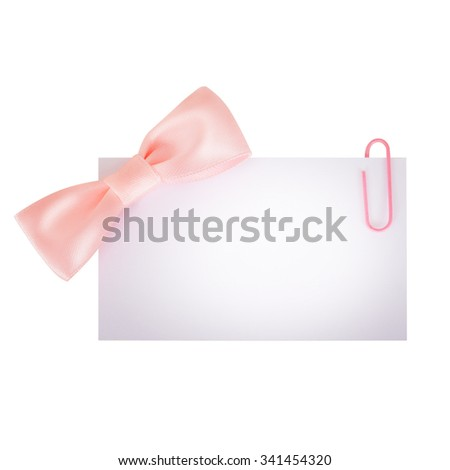 Empty blank old paper price tag or label with pink ribbon isolated - stock photo