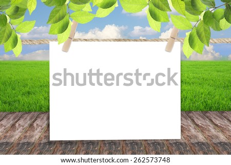 Empty blank paper against blue sky - stock photo