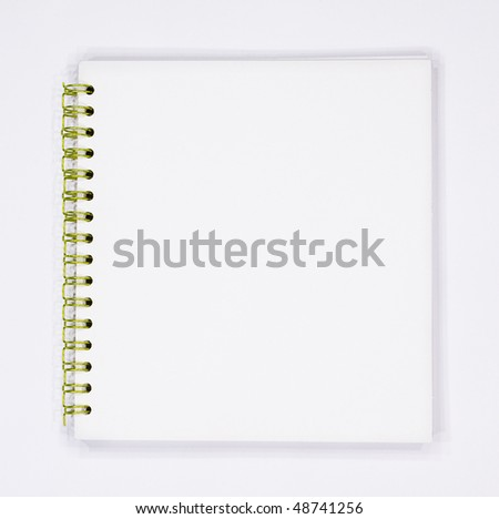 Empty blank spiral pad isolated on white background