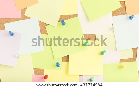 Empty blank sticky notes on notice board in office. Concept image of communication or reminder with copy space.  - stock photo