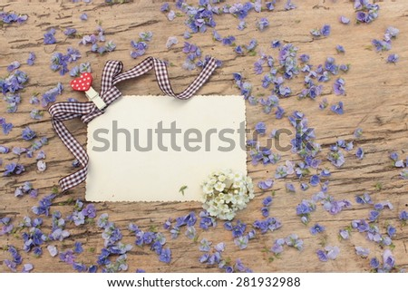 Empty blank with floral background on vintage wooden table - stock photo