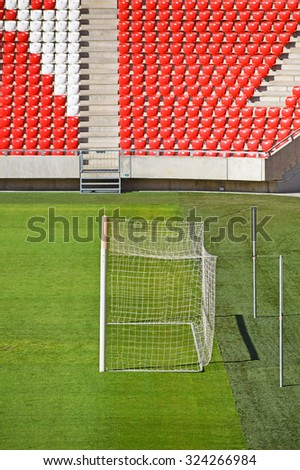 Empty bleachers and the goal in the stadium