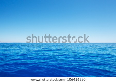 Empty Blue Ocean and Blue Sky - stock photo