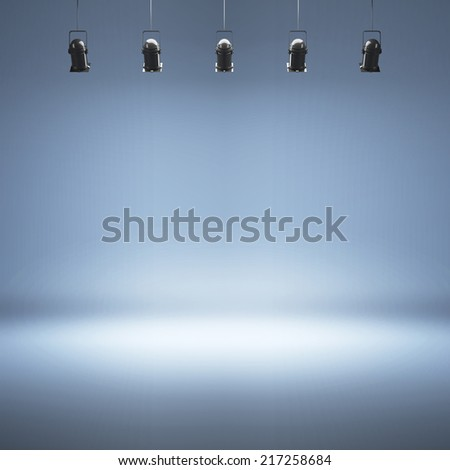 Empty blue photo studio background with spotlights - stock photo
