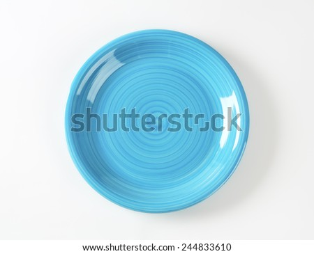 empty blue plate on white background - stock photo