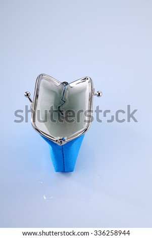 empty blue purse open on the white background