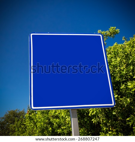 Empty blue road sign. Tropical street