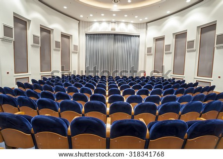 Empty blue seats for cinema, theater, conference or concert. The old theater OLYMPION in Thessaloniki Build 1920 - stock photo
