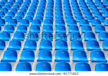 Empty blue seats in a stadium - stock photo
