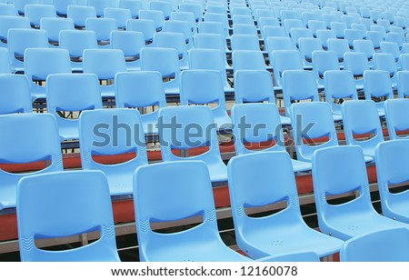 Empty blue seats in an open air environment