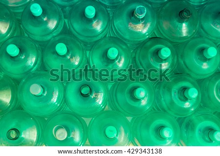 empty blue transparent waters gallon, Overlapping background, green tone - stock photo