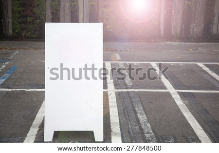 empty board at the parking lot - stock photo