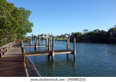 Empty boat dock in Boca Grande, Florida - stock photo