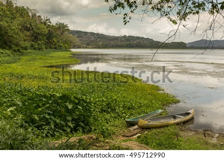 Empty boats at the edge of the Chagres River - Gamboa, Panama
