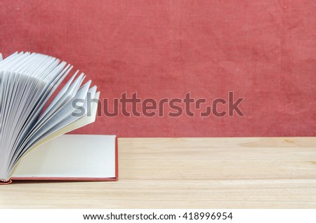 empty book and pen on wooden table - stock photo