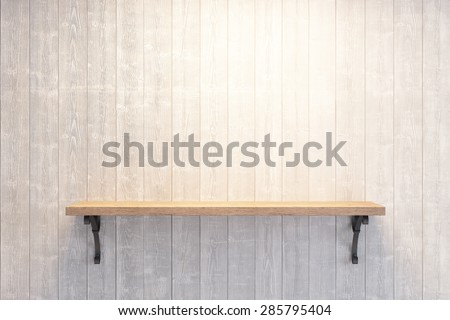 empty book shelf on wooden wall - stock photo