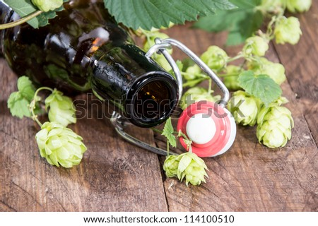 Empty bottle of Beer on wooden background - stock photo