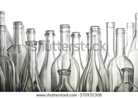 Empty bottles isolated over the white background - stock photo