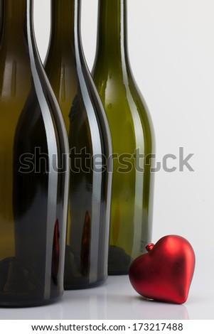 Empty bottles of wine and romantic symbol - stock photo