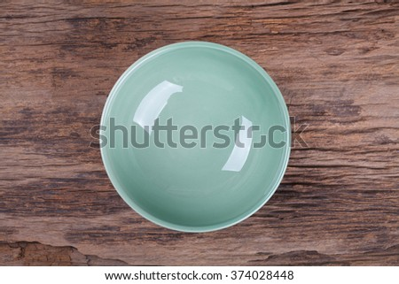 Empty bowl on wood