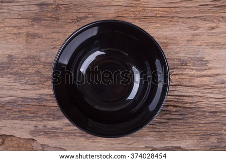 Empty bowl on wood - stock photo