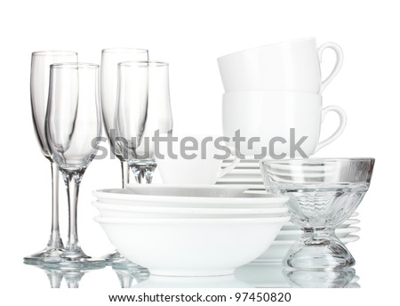 empty bowls, plates, cups and glasses on grey background - stock photo