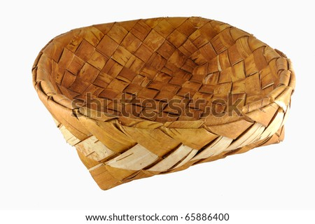Empty braided birch-bark bread box isolated over white background