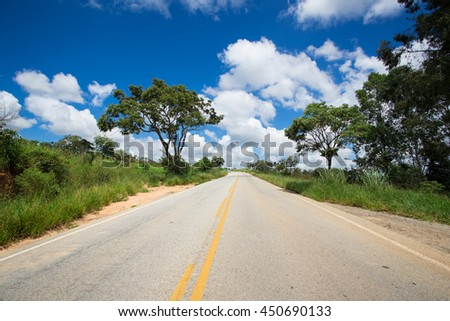 empty brazilian road at sunny cloudy day