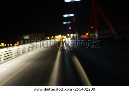 Empty bridge at night with lights closeup - stock photo