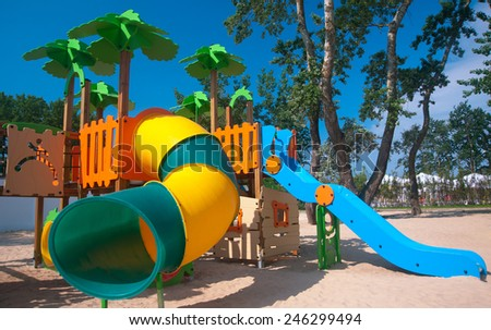 Empty bright and colorful children playground - stock photo
