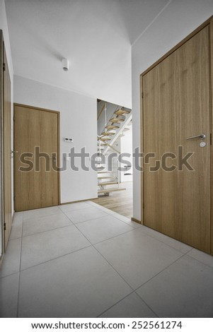 empty bright room with three doors and tiles  - stock photo