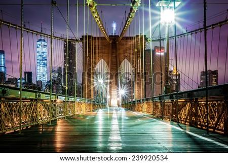 Empty Brooklyn Bridge pedestrian walkway before sunrise. - stock photo