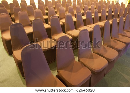 Empty brown chairs - stock photo